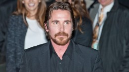 "Actor Christian Bale leaving the press conference for the movie ""American Hustle"""
